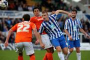 LEARNING HIS GAME: Scott Harrison in action against Luton Town's defence Picture: DAVID WOOD
