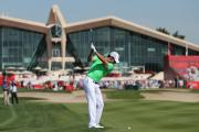 APPROACH: Rory McIlroy of Northern Ireland plays the ninth hole during first round in Abu Dhabi