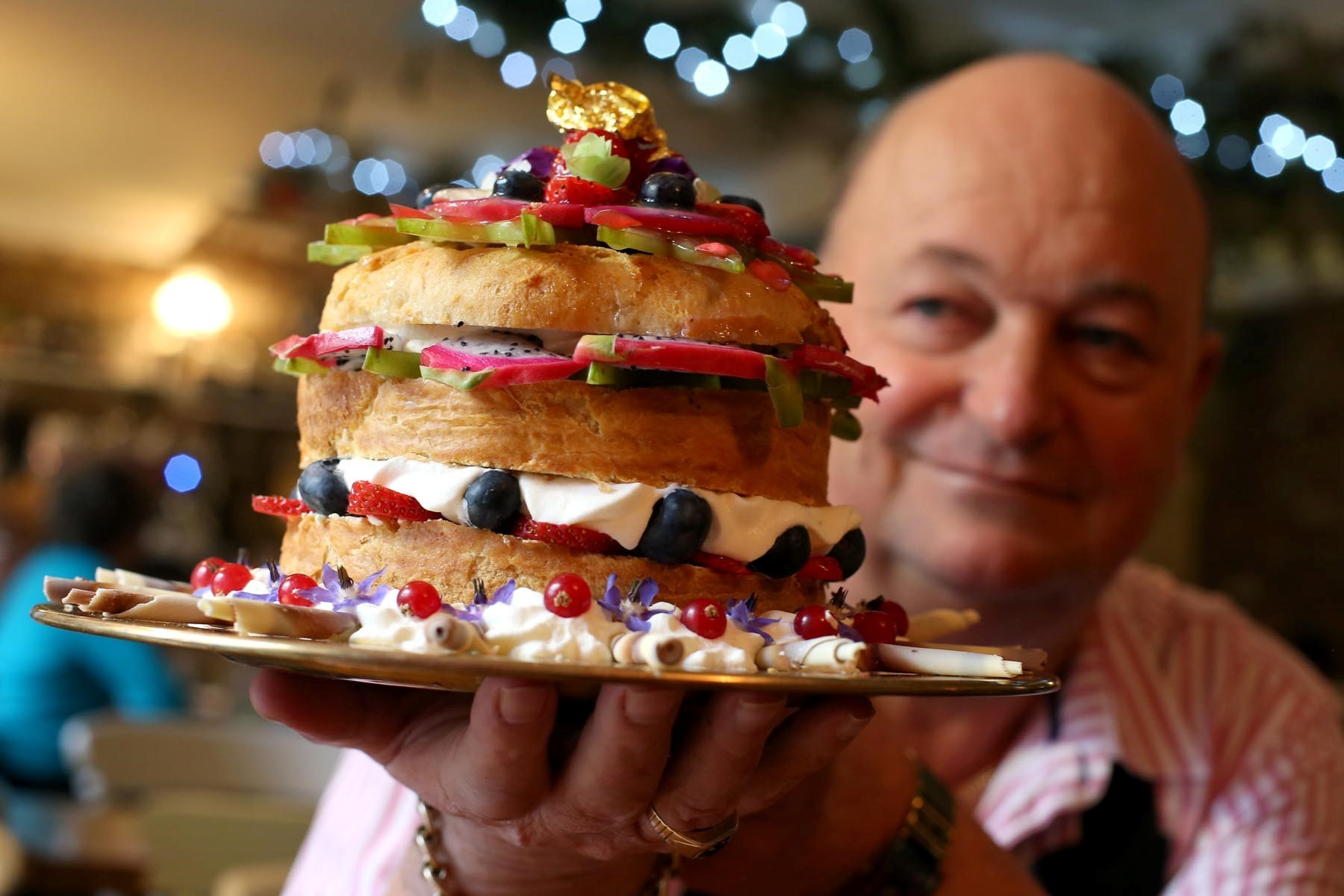 GOING, GOING, SCONE: Court Inn in Durham proprietor Trevor Davis with a giant scone which is to be auctioned off. Picture: CHRIS BOOTH (16673895) - 3493578