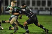 FALCONS FUTURE: Tom Catterick, left, is tackled by Brive's Johanes Coetzee at Kingston Park, Newcastle