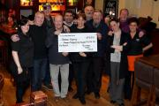 FUNDS: Colin Callaby and friends have raised more than £14,000 for Teesside Hospice. Pictured at the Southern Cross pub on Dixons Bank, Middlesbrough Picture: CHRIS BOOTH