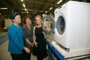 VISIT: Baroness Neville-Rolfe, left, looks at Ebac's washing machine vision, with the company's Pamela Petty, middle, and Amanda Hird     Picture: Keith Taylor