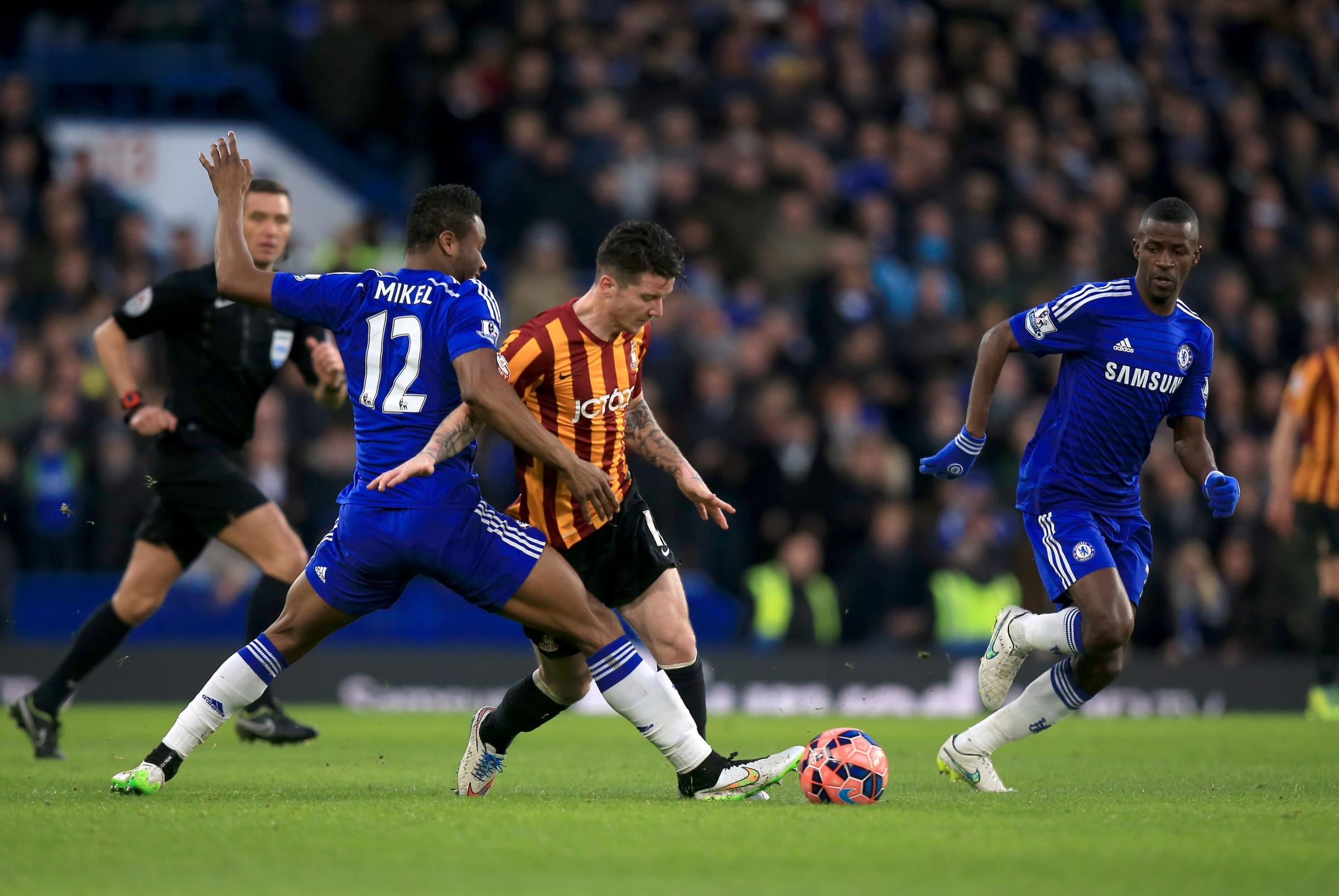 CENTRE STAGE: Billy Knott glides past John Obi Mikel during Bradford's fourth-round win at Chelsea