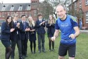 TRAINING: Martin Pearman is cheered on by students at Ripon Grammar School before he embarks on the London Marathon.