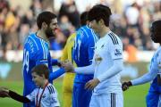 FAMILIAR FACE: Sunderland's Danny Graham and Swansea City's Ki Sung-Yueng greet each other before Saturday's game. Ki was on loan at Sunderland last season. Picture: Nick Potts/PA