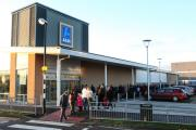 ONLINE RULING: Shoppers queue to enter the Aldi store, in Newton Aycliffe