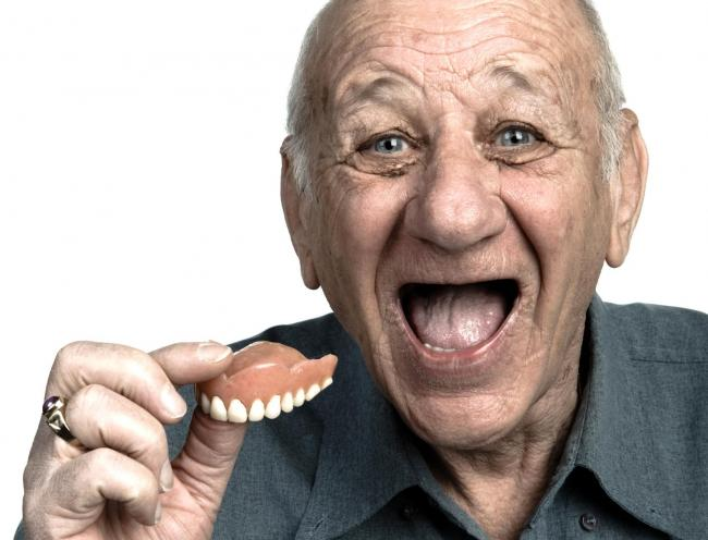 TEETHING PROBLEMS: False teeth is one of the odd things found in the back of Boro Taxis' cabs. Picture posed by model