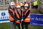 LANDMARK: Wolsingham School and Community College head boy Jordan Wragg, 18, head girl Hannah Porter, 17, and former pupil Doreen Moore, 90, at the sod cutting ceremony to mark the start of renovation of the lower school site Picture: SARAH CALDECOTT