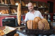 BAKERY: Artisan Baker Alex Lister shows off some of his bread at his Rise Artisan Bakehouse Picture Keith Taylor