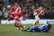TAKING A FALL: Boro's Patrick Bamford and Sheffield Wednesday's Kamil Zayatte clash heads. Pictures: JACK PHILLIPS/CAMERA SPORT