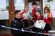SLEUTHS: PCSO Lee Cowley presents prizes to Cockfield Primary School's top junior detectives, from left, Kieron Pattison, eight, William Armiger, 11, Oliver Horley, four, and Ruby Jones, six Picture: ANDY LAMB