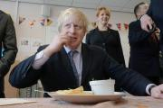 Boris Johnson samples a parmo. PHOTO: North News & Pictures