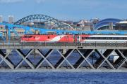 QUESTIONS: A Virgin East Coast train with the Tyne Bridge in the background.