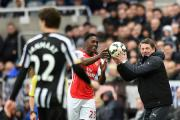 Confident: Newcastle head coach John Carver jokingly gives Arsenal's Danny Welbeck (left) the ball