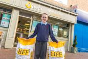 CHIPS: Chip champion George Hoy, 11, celebrates winning his weight in chips – the equivalent of three bags of potatoes - with Oliver's owner Mike Roberts and team member Lee Himsworth.