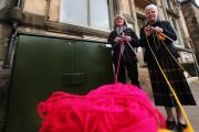 KNITTERS: Staindrop knitters plan to knit a cover for an ugly BT box that's been put on the front of Scarth Hall pictured Sandra May and Joan Harrison Picture: SARAH CALDECOTT