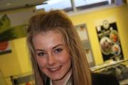 NETWORKING: Year 10 student Amelia Stapley, 14, serves guests refreshments.