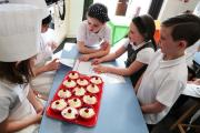 CAKE: Children from Kirk Merrington Primary School were involved in cooking healthy fruit desserts invented by other pupils Picture: SARAH CALDECOTT