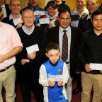 The Northern Echo: FUNDING: Representatives from local sporting organisations receive their cheques from Richmondshire Local Sports Association Picture: DAVID WOOD