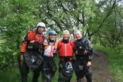 EXPLORING: Paul Rose, second right, joins kayakers while travelling along the The Pennine Way for a TV series marking its 50th year