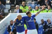 BIG WIN: Leicester striker Leonardo Ulloa (right) celebrates scoring the first goal of his side's 2-0 victory over Swansea City