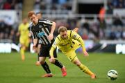 Newcastle United's Jack Colback and Tottenham Hotspur's Christian Eriksen (right) battle for the ball during the Barclays Premier League match at St James' Park, Newcastle. PRESS ASSOCIATION Photo. Picture date: Sunday April 19, 2015. See PA story SOCCER