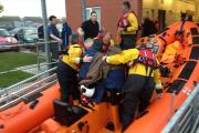 RESCUE OPERATION: The two men are taken from the lifeboat to an ambulance. Pic: Tom Collins