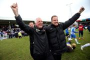 Joy: Pools boss Moore and assistant Sam Collins