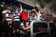 GOING UP: Manager Martin Gray is hoisted aloft as Darlington celebrate winning their win second promotion in two seasons. Picture: CHRIS BOOTH