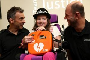 Ten-year-old Grace presented with a defibrillator and a £1,000 cheque