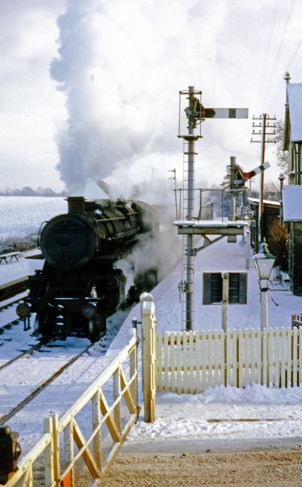 The Northern Echo: SNOW SCENE: A goods train entering the yard at Piercebridge on December 28, 1962. Photograph by John Boyes and courtesy of the JW Armstrong Trust. Today's front cover shows a train entering Piercebridge from Barnard Castle, going past Len Abram's sign