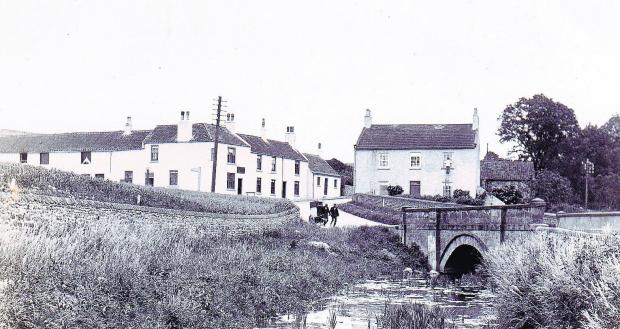 The Northern Echo: LOST HAMLET: A cart careers down Carlbury bank into Piercebridge on this Edwardian postcard. The building on the left is the Railway Inn
