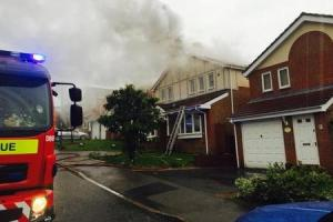 Hero neighbours fight flames after lightning sets house on fire
