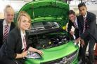 LEARNING: Darlington School of Mathematics and Science students get under the bonnet at Vauxhall dealer Sherwoods. Pictured are Rebecca Smith, Kristen Morrison, Nizam Uddin and Carl Younghusband