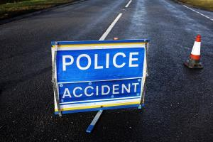 Woman cut free from vehicle after collision