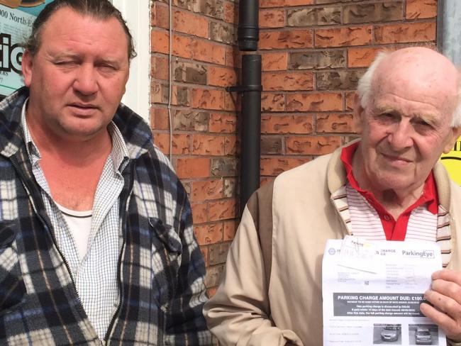 PAYMENT: Jeff Fishburn (left) and Maurice Simpson, with his parking charge notice