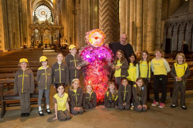 The Northern Echo: ROSE WINDOW: The 4th Durham City St John's Brownies, Nevilles Cross, with the first section of the life-sized Rose Window by Mick Stephenson for this year's Lumiere Litre of Light charity campaign. Picture: STEVEN LANDLES  (42146496)