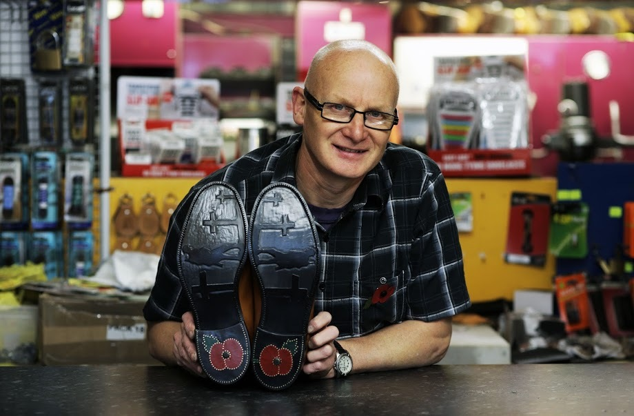 National Shoe Repairer of the Year, Ken Simpson, from Shildon, with the Remembrance Day themed shoes he created and sold on Ebay for £160 to share between Help For Heroes and the Royal British Legion