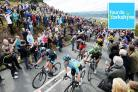 Team Sky's David Lopez (left) nears the summit of the Cote de Cow and Calf during the Tour de Yorkshire between Wakefield and Leeds last year