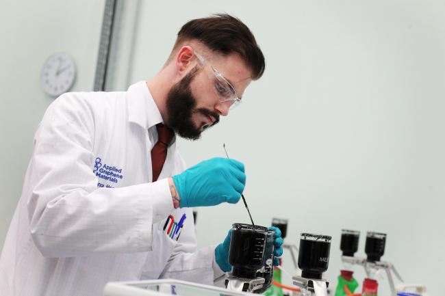 TESTS: A laboratory worker carries out tests at Applied Graphene Materials		Picture: SARAH CALDECOTT