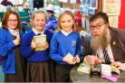Philip Ardagh signs books for South Kilvington Primary School pupils