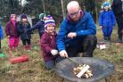 Angel Jowett, five, a pupil at Ox Close Primary School, Spennymoor, learns in the great outdoors with Sam Jackson, of Sc.out.ed