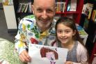 Book fan Ivy Lee with author and illustrator Nick Sharratt in Stockton's Drake bookshop