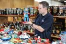 Auctioneer Andy Reed, of Vectis Auctioneers, is selling 1000 toy robots. Picture: TOM BANKS