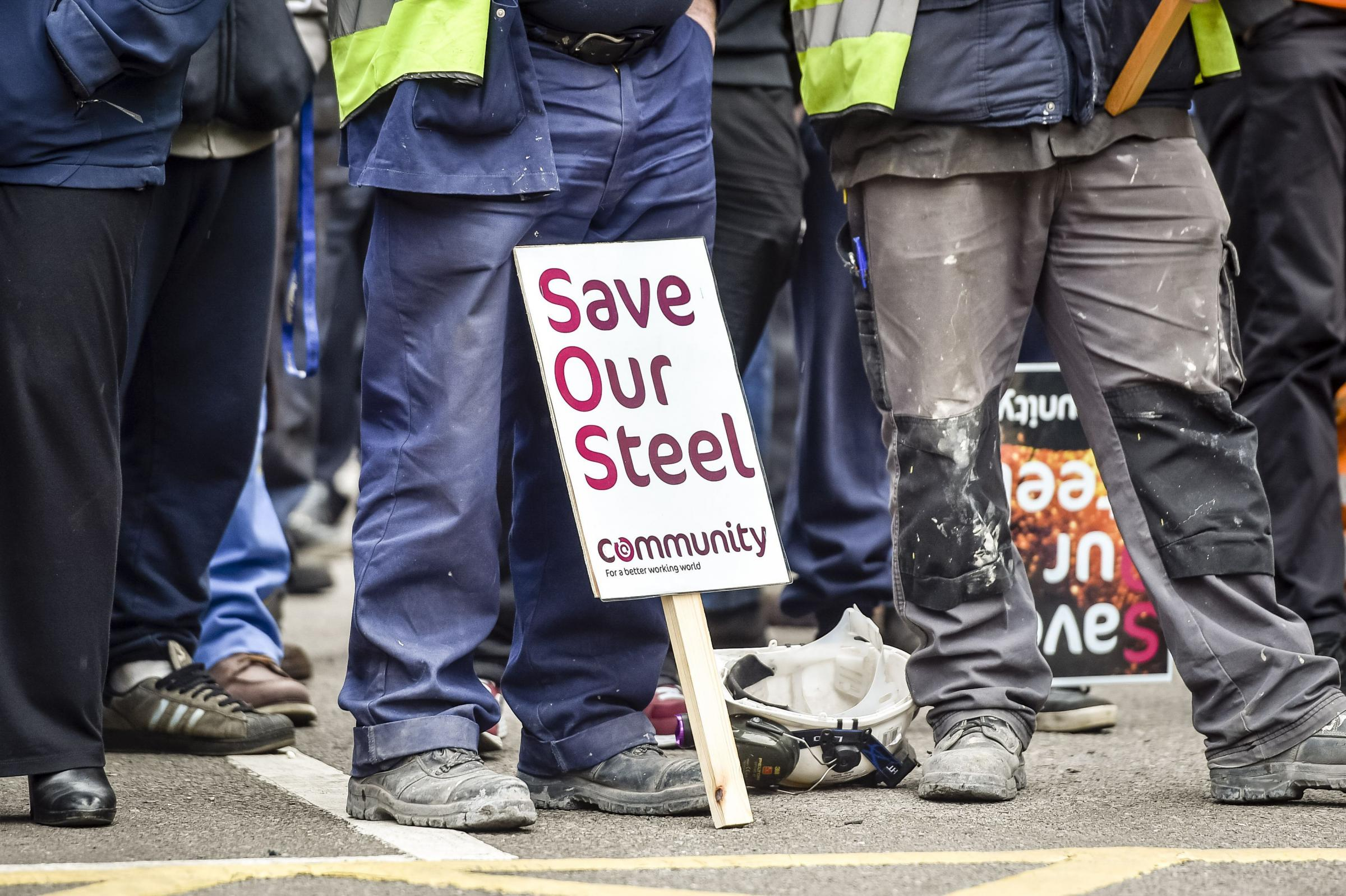 Workers wait to speak to Business Secretary Sajid Javid as he leaves Tata  Steel in Port Talbot, South Wales. Picture: Ben Birchall/PA Wire