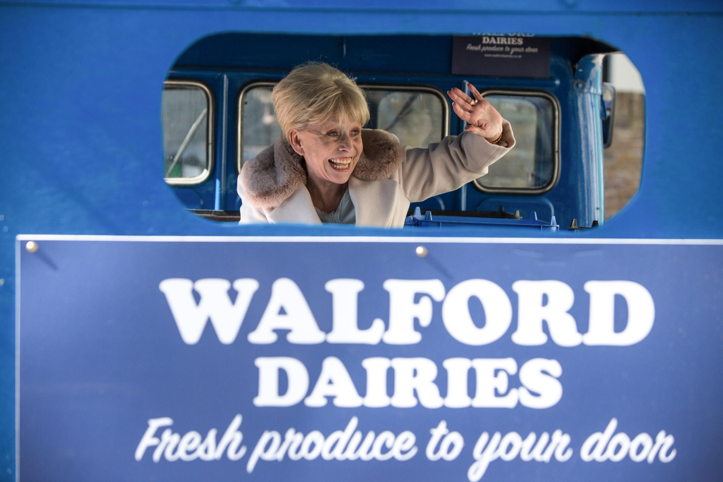 Peggy Mitchell (Barbara Windsor) takes a trip on the back of the milk float as it passes through Albert Square in EastEnders