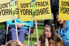 Young protestors demonstrating against fracking wait outside County Hall, Northallerton, during the crunch meeting. Picture: John Giles/PA Wire.