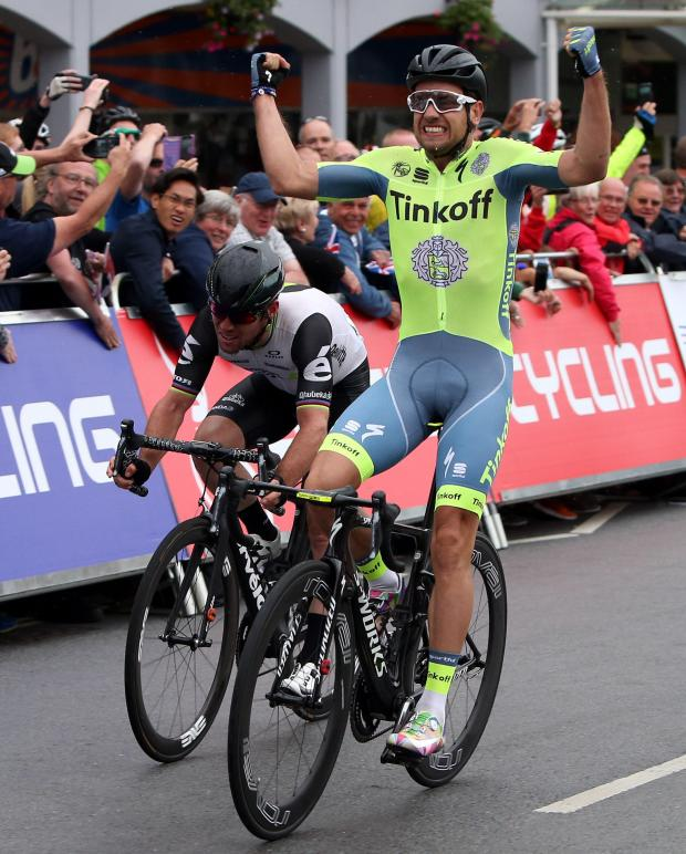 The Northern Echo: Adam Blythe, right, celebrates after winning the Men's Road race alongside second placed Mark Cavendish, left, during the British Cycling National Road Championships in Stockton.