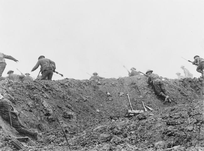 ATTACK: British soldiers go over the top from a shallow assembly trench during the Battle of the Somme. Picture courtesy of the Imperial War Museum