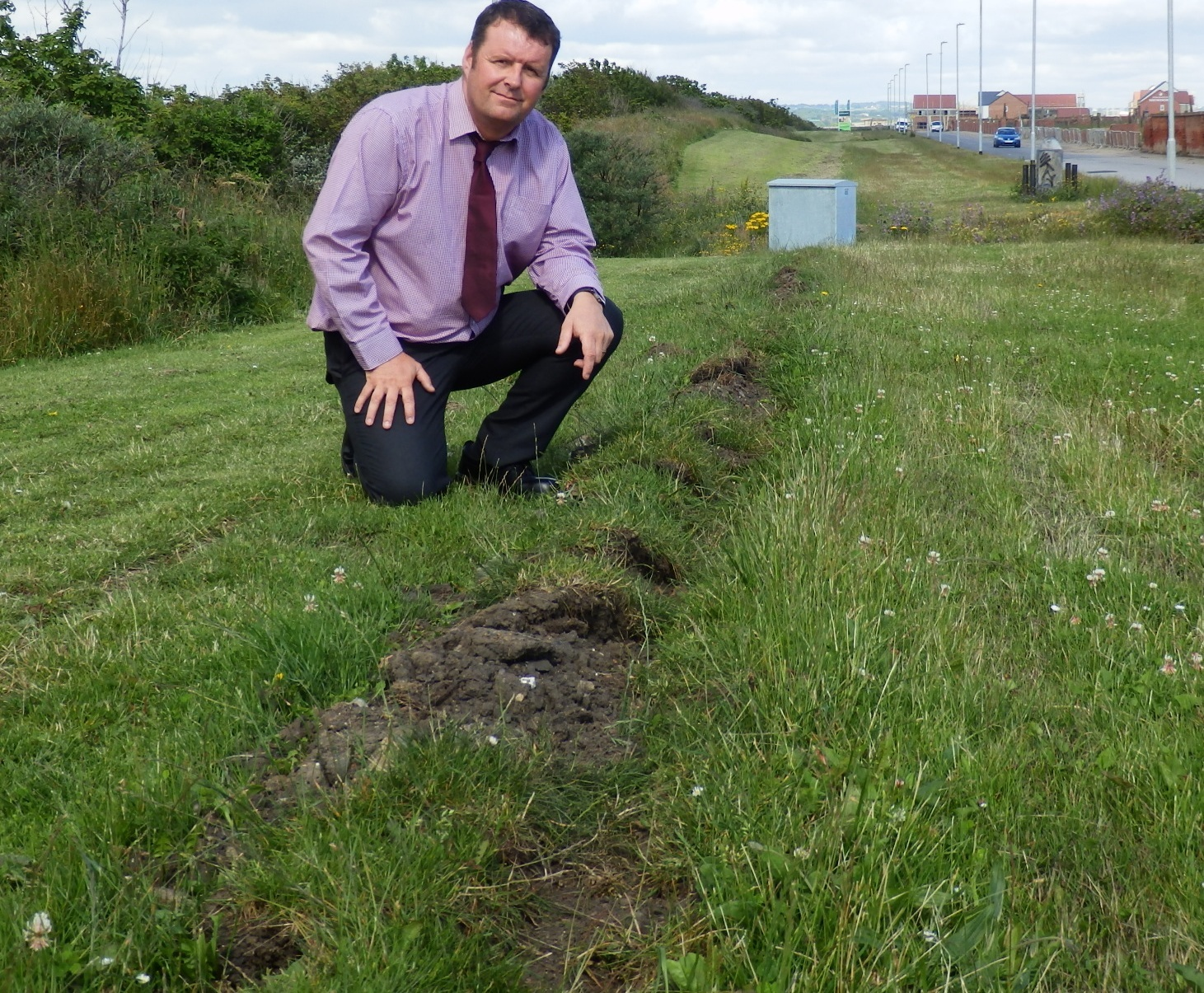 Hartlepool Council's public lighting officer Rob Daley shows where the cable was dragged out of the ground, with the damaged control box in the background